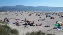 Hotter than Spain! Rare Easter heatwave packs Wales beach