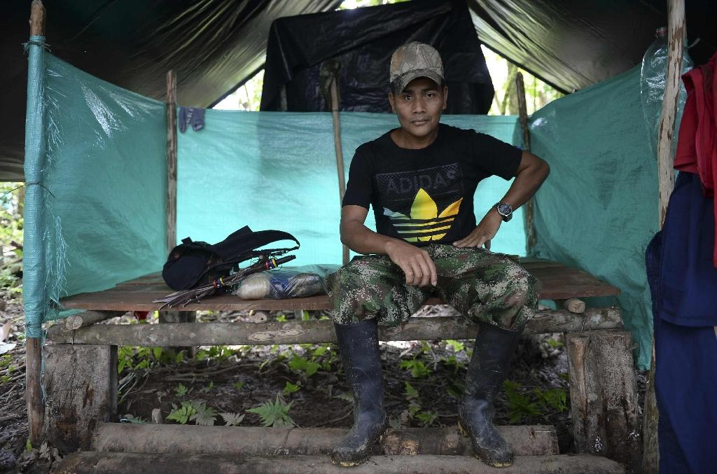 """""""Nobody likes war,"""" said Sebastian, a guerrilla who lost his right eye in a 1998 skirmish with paramilitary fighters, """"but sometimes you have to do it"""" (AFP Photo/Raul ARBOLEDA)"""