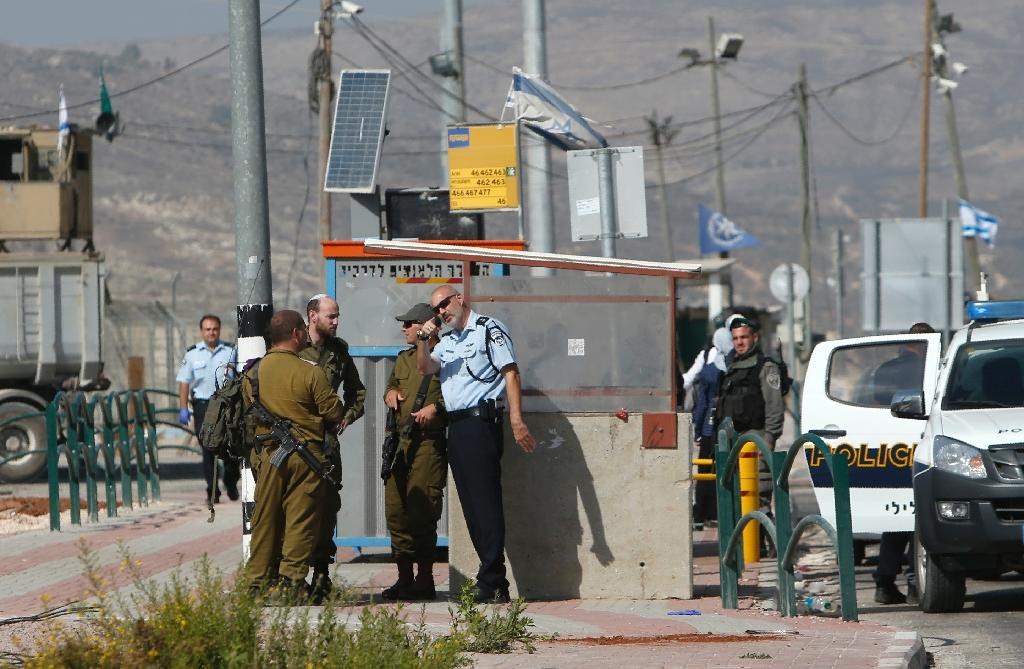 Israeli security forces gather near the Tapuah junction, also known as the Zaatara junction, south of the city of Nablus in the Israeli occupied West Bank