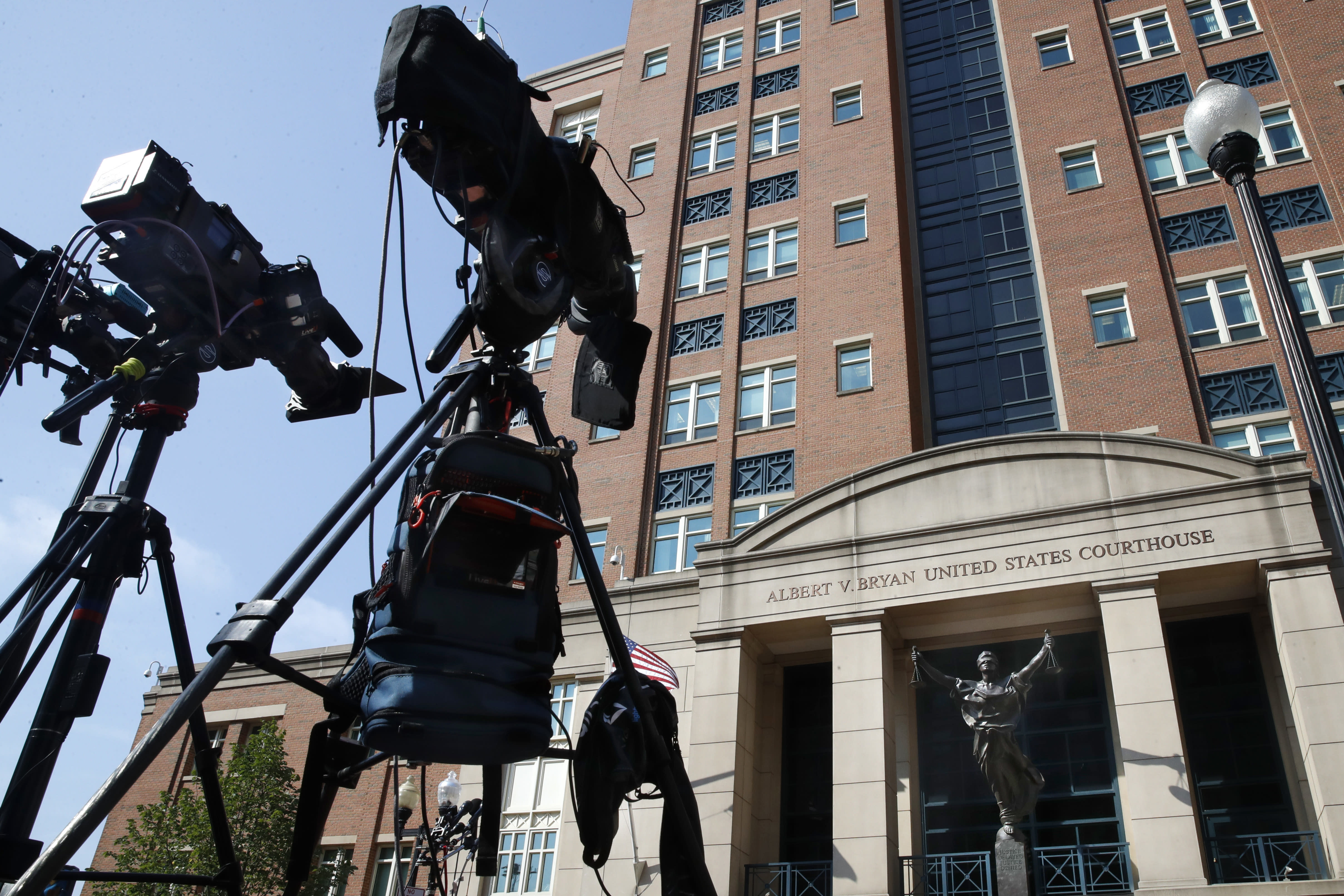 Television cameras are set up outside as the trial of former Trump campaign chairman Paul Manafort continues at federal court in Alexandria, Va., Tuesday, Aug. 7, 2018. (AP Photo/Jacquelyn Martin)