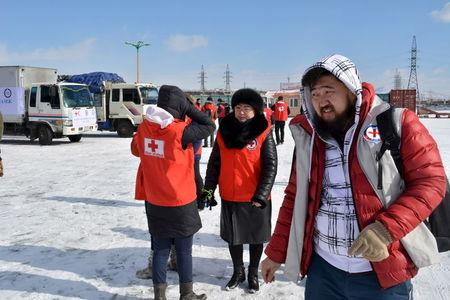 Red cross workers prepare to send trucks to deliver food and monetary aid to eight provinces over Mongolia's vast steppe, mountains and frozen rivers from Ulan Bator, Mongolia, February 26, 2016. Global aid agencies are responding to a call for assistance by Mongolia as harsh winter weather raises fears for the safety and livelihoods of the country's traditional pastoralists, who have already been hit hard by a drought last year. Picture taken February 26, 2016. REUTERS/Terrence Edwards EDITORIAL USE ONLY. NO RESALES. NO ARCHIVE