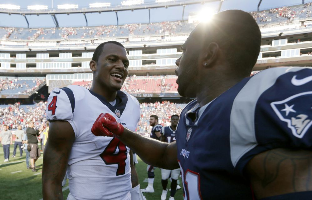 Houston Texans quarterback Deshaun Watson (4) donated his first NFL game check to three stadium workers affected by Hurricane Harvey. (AP)