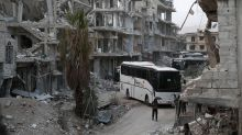 Syria rebels, civilians leave penultimate Ghouta pocket