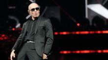 Pitbull to Embark on Motivational Speaking Tour With 'Hero' Life Coach Tony Robbins