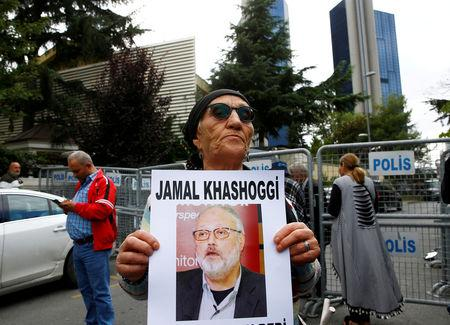 FILE PHOTO: A human rights activist holds picture of Saudi journalist Jamal Khashoggi during a protest outside the Saudi Consulate in Istanbul, Turkey October 9, 2018. REUTERS/Osman Orsal