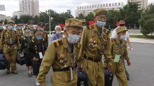 North Korea locks down border city over suspected virus case