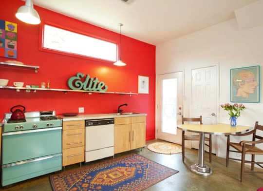 """<p>Kitchens painted in perky shades such as lemon yellow, turquoise, and cotton-candy pink were wildly popular in mid-century homes. Make a modern nod to this <a href=""""http://www.bobvila.com/slideshow/7-ways-your-paint-picks-affect-your-mood-49079?bv=yahoo"""" rel=""""nofollow noopener"""" target=""""_blank"""" data-ylk=""""slk:mood-boosting"""" class=""""link rapid-noclick-resp"""">mood-boosting</a> approach by painting a kitchen accent wall in a gorgeous, unexpected hue.</p><p><b>Related: <a href=""""http://www.bobvila.com/slideshow/awesome-accents-17-ways-to-make-any-space-pop-with-color-46922?bv=yahoo"""" rel=""""nofollow noopener"""" target=""""_blank"""" data-ylk=""""slk:Awesome Accents—17 Ways to Make Any Space Pop with Color"""" class=""""link rapid-noclick-resp"""">Awesome Accents—17 Ways to Make Any Space Pop with Color</a> </b> </p><p><i>Source: Bob Vila</i></p>"""
