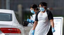 Theme park opens drive-through testing unit as UK ramps up coronavirus response