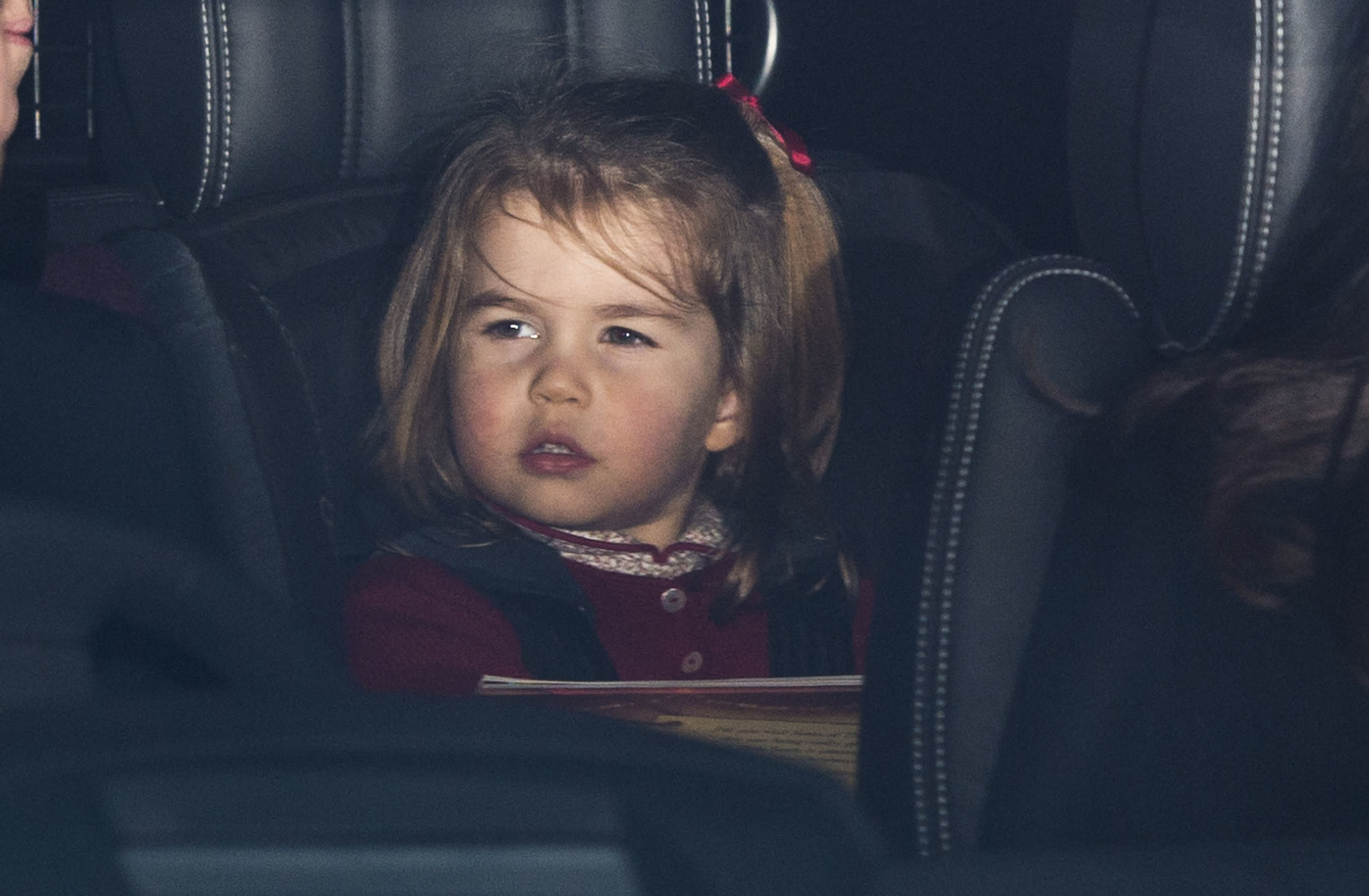 LONDON, ENGLAND - DECEMBER 20: Princess Charlotte of Cambridge attends a Christmas lunch for the extended Royal Family at Buckingham Palace on December 20, 2017 in London, England. (Photo by Mark Cuthbert/UK Press via Getty Images)