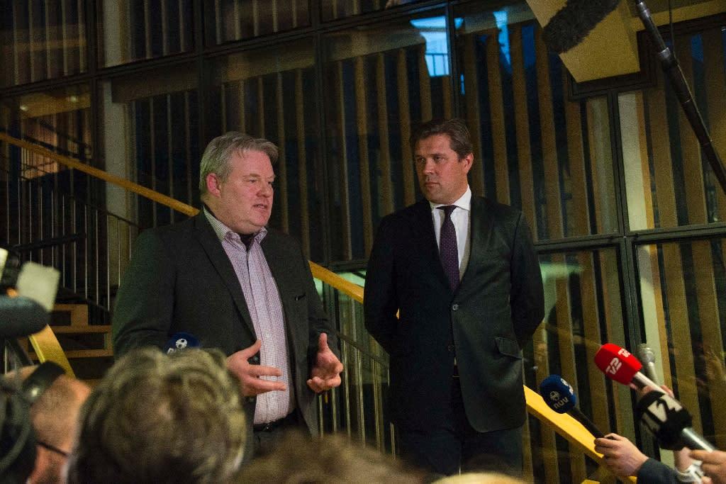 Iceland's new Prime Minister Sigurdur Ingi Johannsson (L) of the Progressive Party's and Bjarni Benediktsson (R), finance minister of the Independence Party, address members of the media in Reykjavik, Iceland on April 6, 2016 (AFP Photo/Halldor Kolbeins)