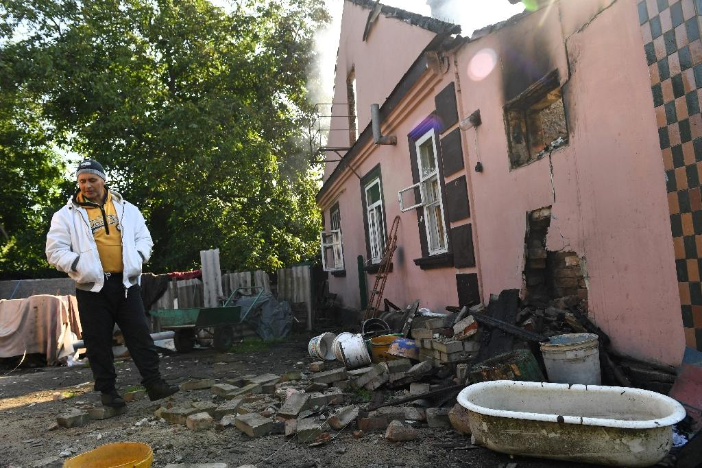 Explosions could be heard every five to 10 minutes and streets of the town of 20,000 were nearly deserted. (AFP Photo/Sergei SUPINSKY)