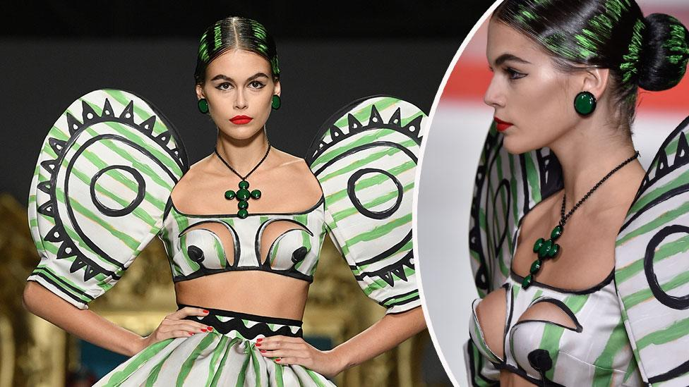 Cindy Crawford's lookalike daughter models racy cut-out top on the runway