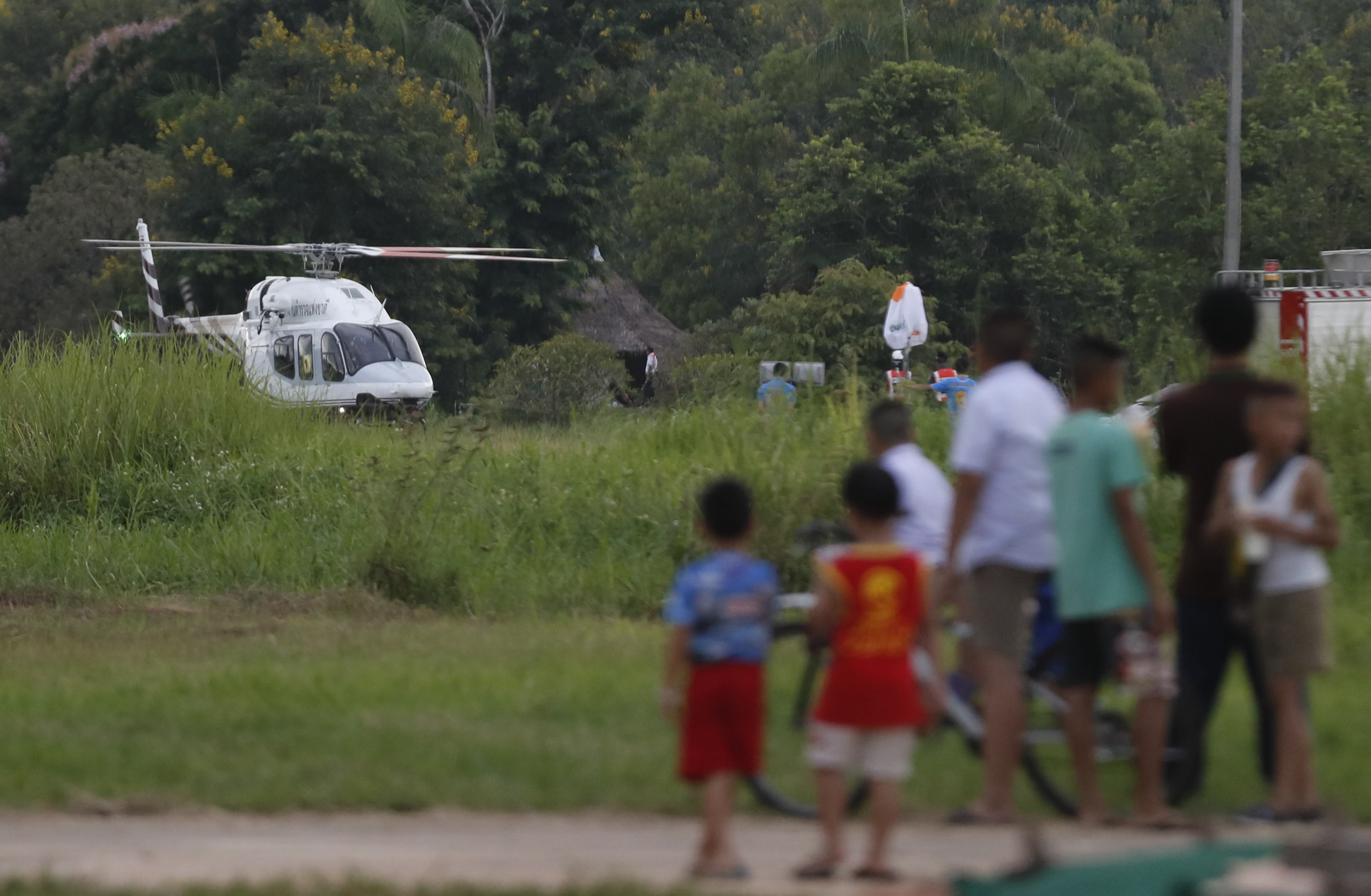 <p>A helicopter believed to be carrying one of the boys rescued from the flooded cave lands in Chiang Rai as divers continue to extract the remaining boys and their coach trapped at Tham Luang cave in the Mae Sai district in Chiang Rai province, northern Thailand, Tuesday, July 10, 2018. (Photo: Vincent Thian/AP) </p>