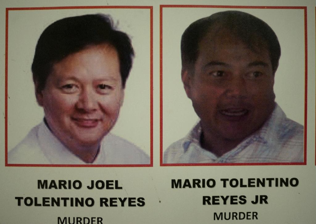 Siblings Joel and Mario Reyes are running for mayor and vice-mayor respectively of the resort town of Coron even though they are in jail for allegedly masterminding the murder of a prominent environmentalist in 2011 (AFP Photo/Noel Celis)