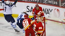Jets end skid, clinch playoff spot, with win over Flames