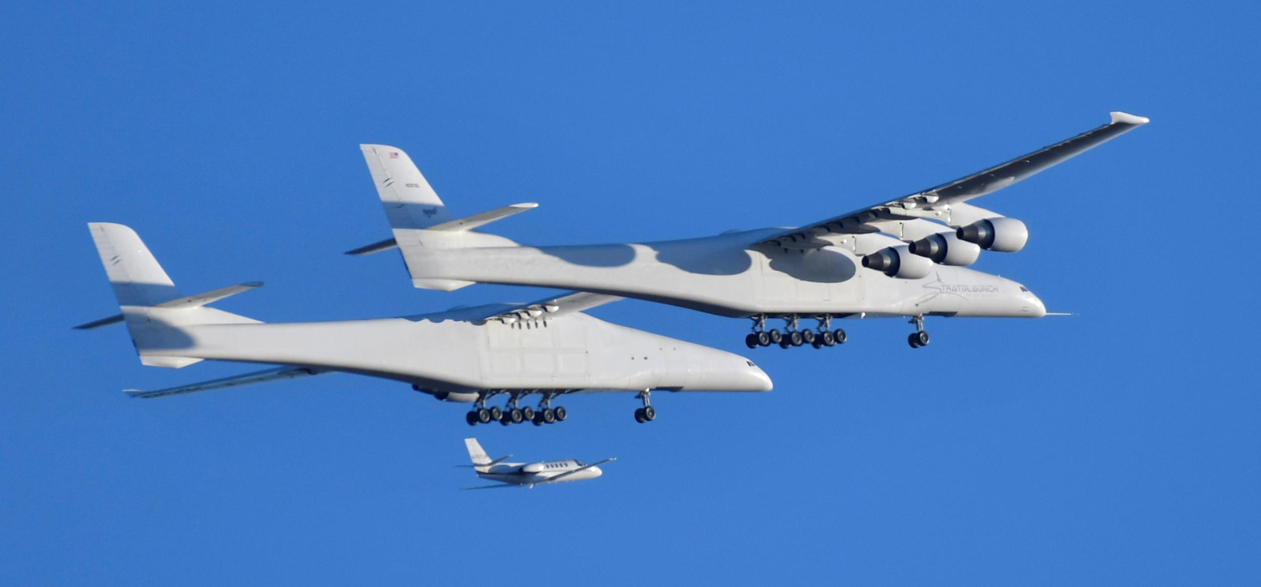 The world's largest airplane, built by the late Paul Allen's company Stratolaunch Systems, makes its first test flight in Mojave, California, U.S. April 13, 2019.  REUTERS/Gene Blevins