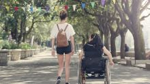 Woman says stranger called her wheelchair a hoax after she stood for a few moments at Disney World