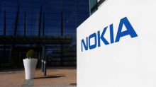 Nokia cuts full-year profit forecast, sets new strategy