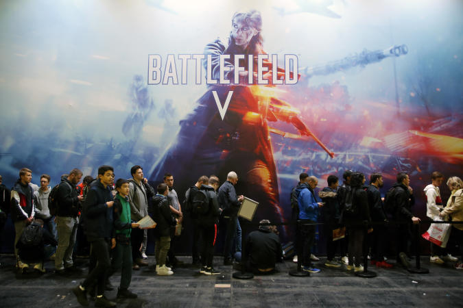 """PARIS, FRANCE - OCTOBER 27:  Visitors queue to play the video game """"Battlefield V"""" developed by DICE and published by Electronic Arts (EA) during the 'Paris Games Week' on October 27, 2018 in Paris, France. 'Paris Games Week' is an international trade fair for video games and runs from October 26 to 31, 2018.  (Photo by Chesnot/Getty Images)"""