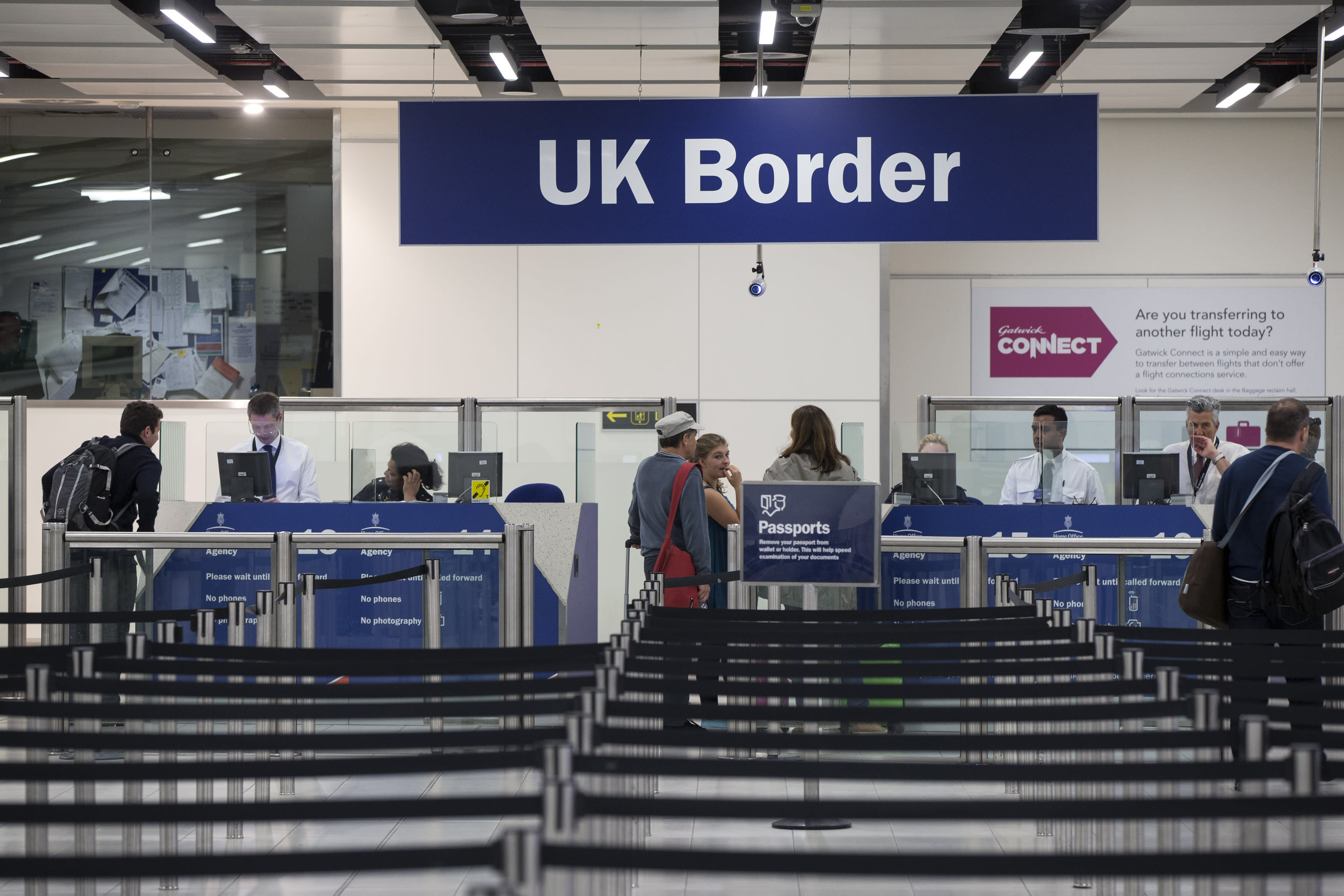 UK government told to keep controversial migrant salary cap