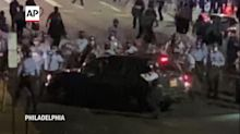 Police smash car windows, family trapped at protest