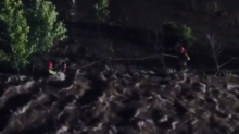 Oklahoma Firefighters Rescue Driver Clinging to Fence After Car Swept Into 'Raging Water'