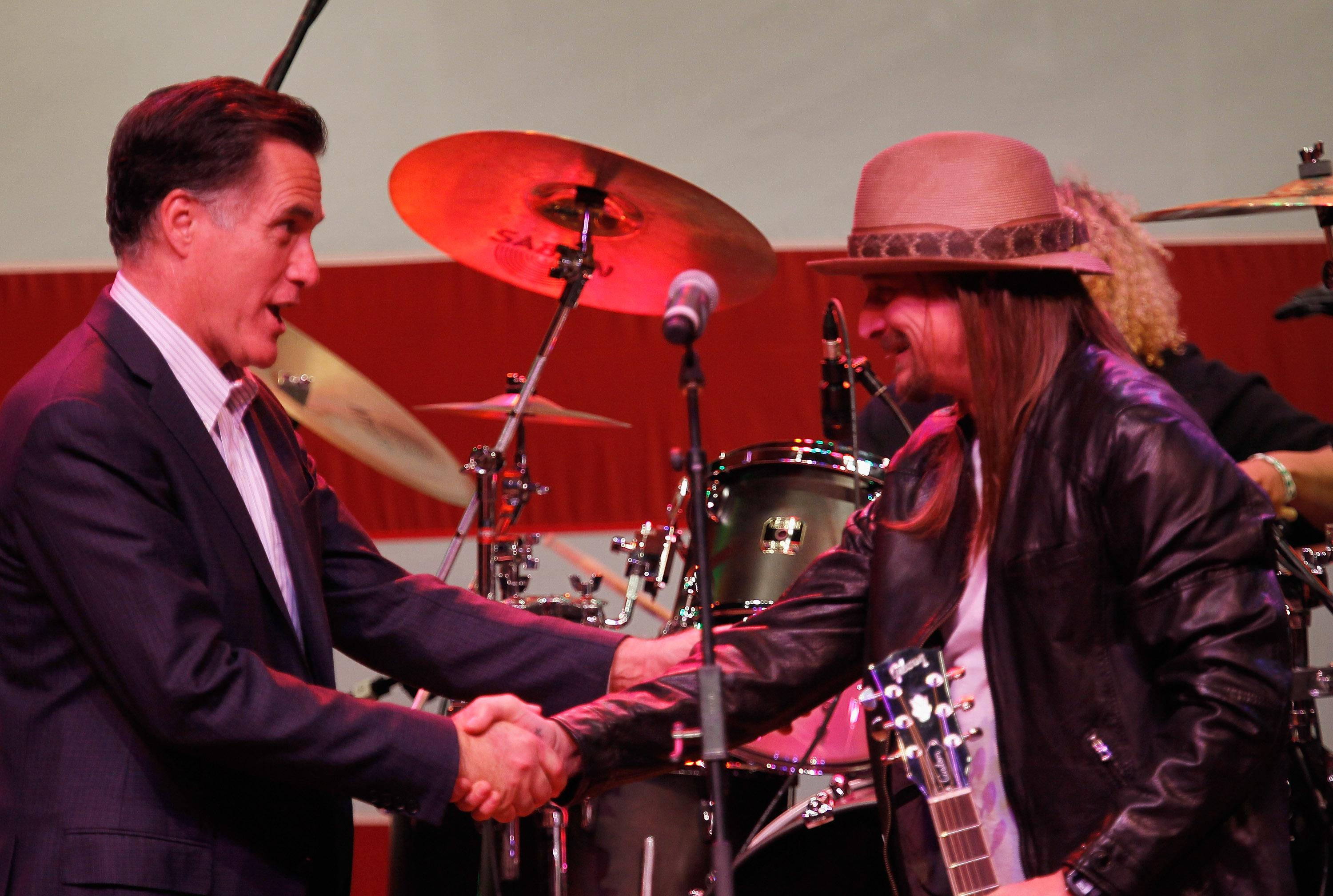 ROYAL OAK, MI - FEBRUARY 27: Republican presidential candidate, former Massachusetts Gov. Mitt Romney shakes hands with musician Kid Rock during a campaign event at the Royal Oak Music Theatre on February 27, 2012 in Royal Oak, Michigan. Michigan residents will go to the polls on February 28 to vote for their choice in the Republican presidential race. (Photo by Joe Raedle/Getty Images)