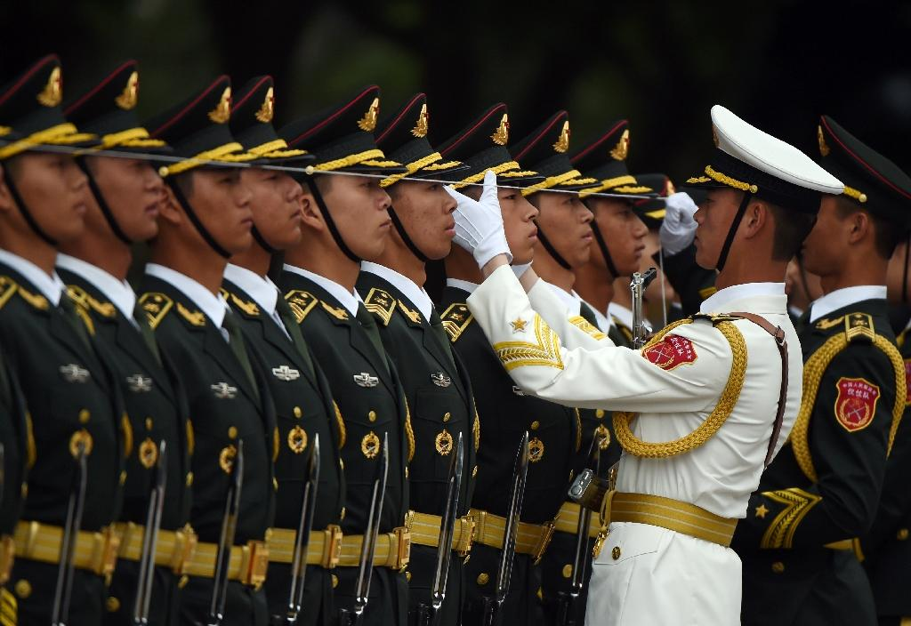 Chinese soldiers prepare for an honour guard for India's Prime Minister Narendra Modi outside the Great Hall of the People in Beijing (AFP Photo/Greg Baker)