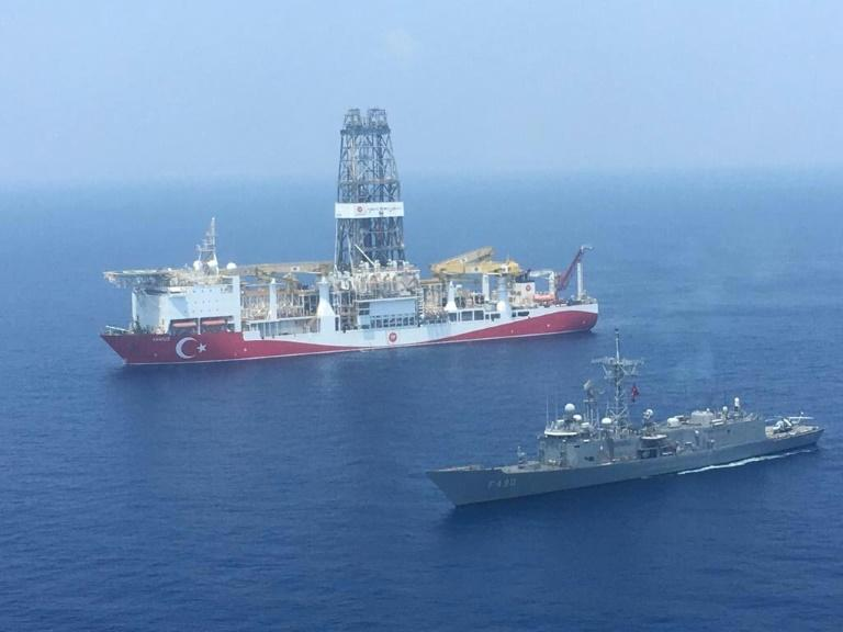 A Turkish navy warship patrols next to Turkey's drilling ship 'Fatih' sent to waters off Cyprus