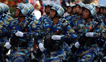 Soldiers hold rifles while marching during a celebration to mark Reunification Day in Ho Chi Minh city, Vietnam April 30, 2015. REUTERS/Kham