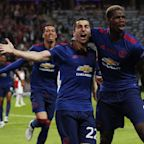 Manchester United lift the Europa League trophy to secure Champions League football for next season