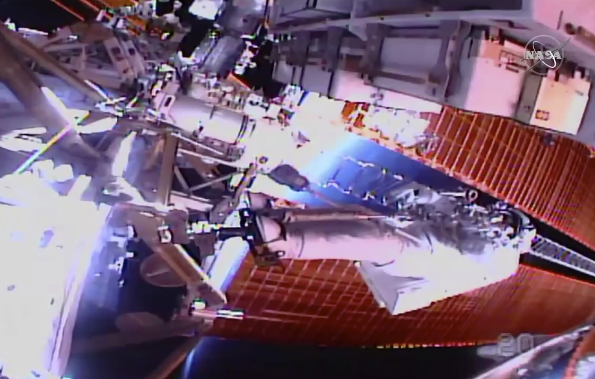 Spacewalking astronauts closing in on final battery swaps outside International Space Station