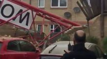 People injured after crane collapses on houses