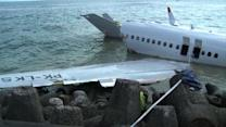 Bali investigators begin retrieving jet wreckage
