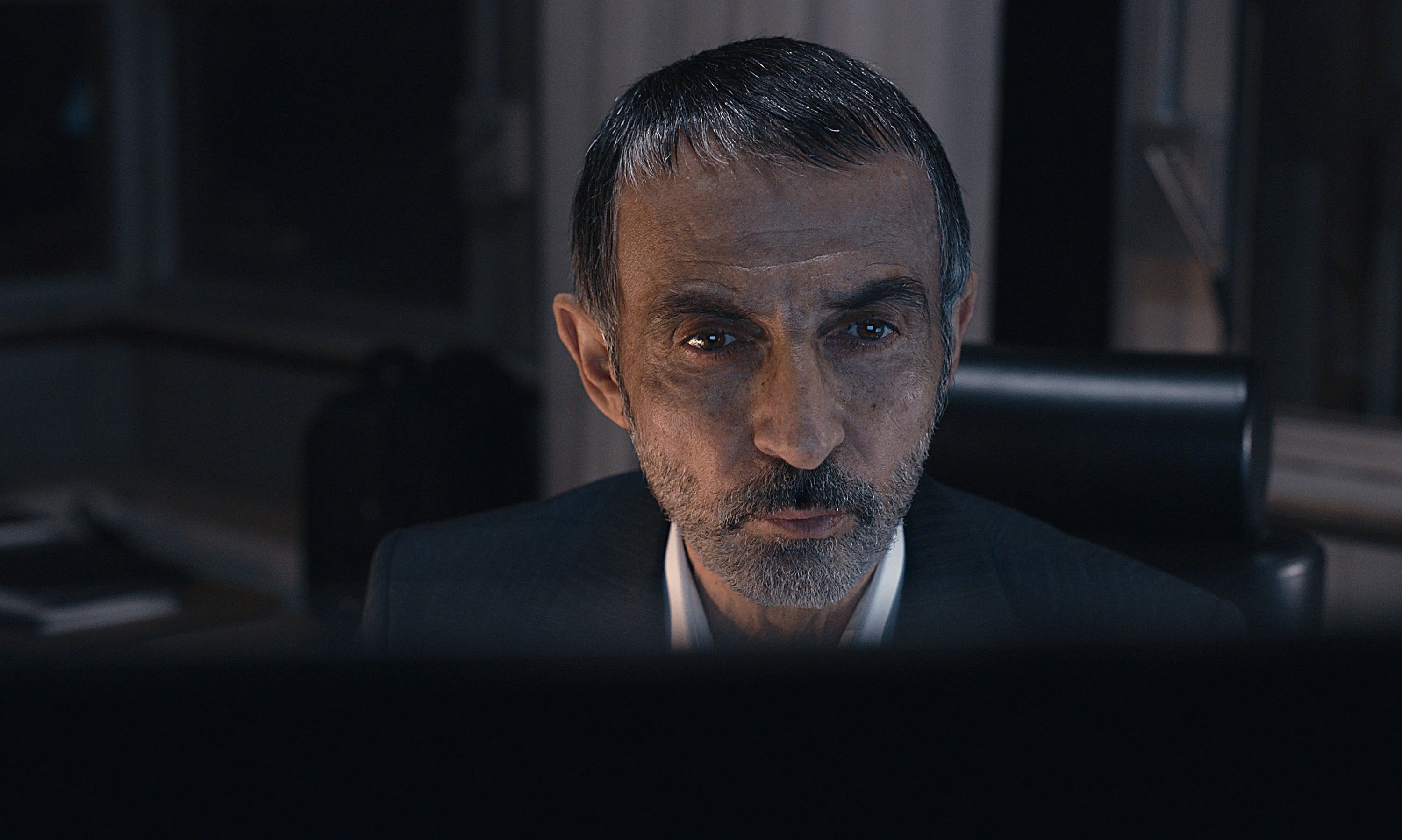 """This image released by Apple TV+ shows Shaun Toub as Faraz Kamali in a scene from """"Tehran."""" (Apple TV+ via AP)"""