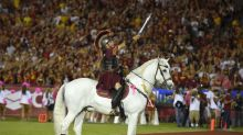 Games go on, but many traditions on hold in college football