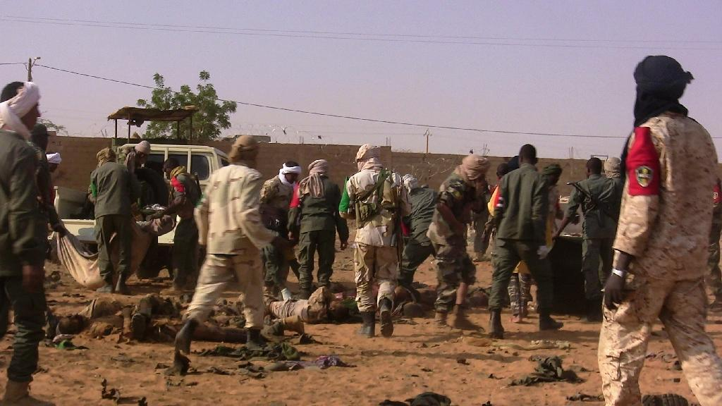 The dead and injured are evacuated following a suicide bomb attack that ripped through a camp grouping former rebels and pro-government militia in Gao, in northern Mali (AFP Photo/STRINGER)