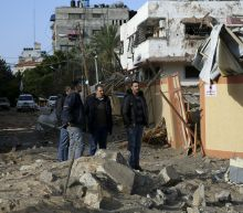 The Latest: Israel warns Hamas against further attacks