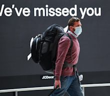 A vaccinated New Zealand airport worker tested positive for COVID-19 one day after the country opened a travel bubble with Australia