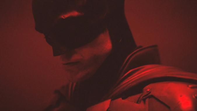 A dark black and red profile photo of Pattinson's The Batman.