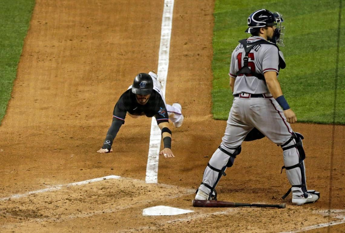 Speed, small ball key all-around effort as first-place Marlins thrash Braves in home opener