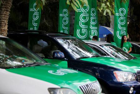 Grab cars are seen during a launch ceremony in Phnom Penh, Cambodia, December 19, 2017. REUTERS/Samrang Pring/Files