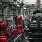 Tesla dives, but analysts stay bullish: Job cuts signal 'productivity gains'