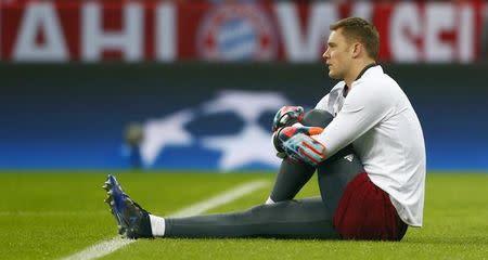 Bayern Munich's Manuel Neuer warms up before the match