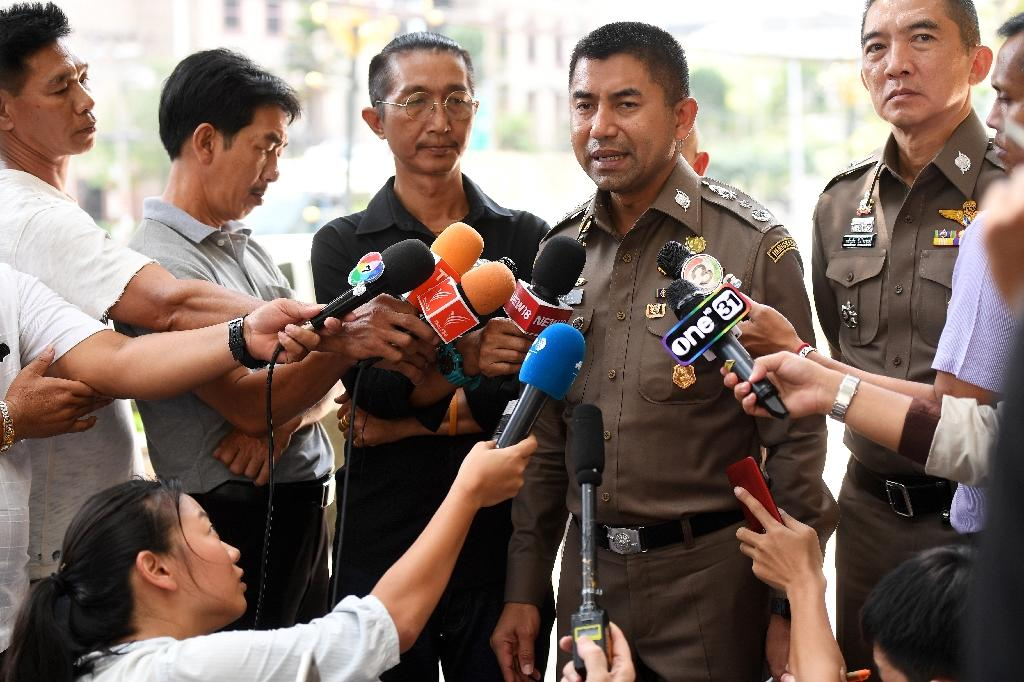 "Thai immigration chief Surachet Hakparn responded on Twitter too, saying ""we stand for humanity"" (AFP Photo/Lillian SUWANRUMPHA)"
