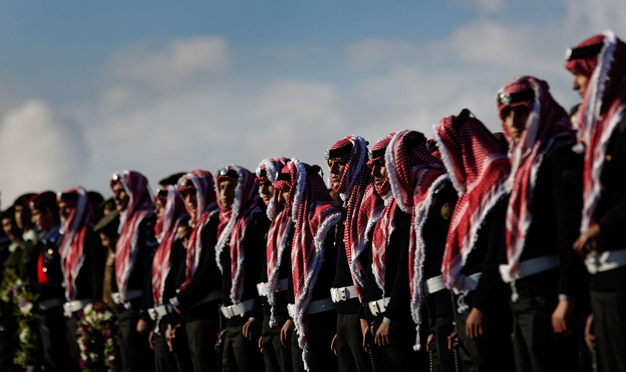<p>Members of the Jordanian Gendarmerie line the road ahead of the funeral of their killed colleague Lieutenant Colonel Saed al-Maaytah, near the town of Karak, about 140 kilometers (87 miles) south of the capital Amman, in Jordan Monday, Dec. 19, 2016. Gunmen assaulted Jordanian police in a series of attacks Sunday, including at the Karak Crusader castle popular with tourists, killing seven officers, two local civilians and a woman visiting from Canada, officials said. (Photo: Ben Curtis/AP) </p>