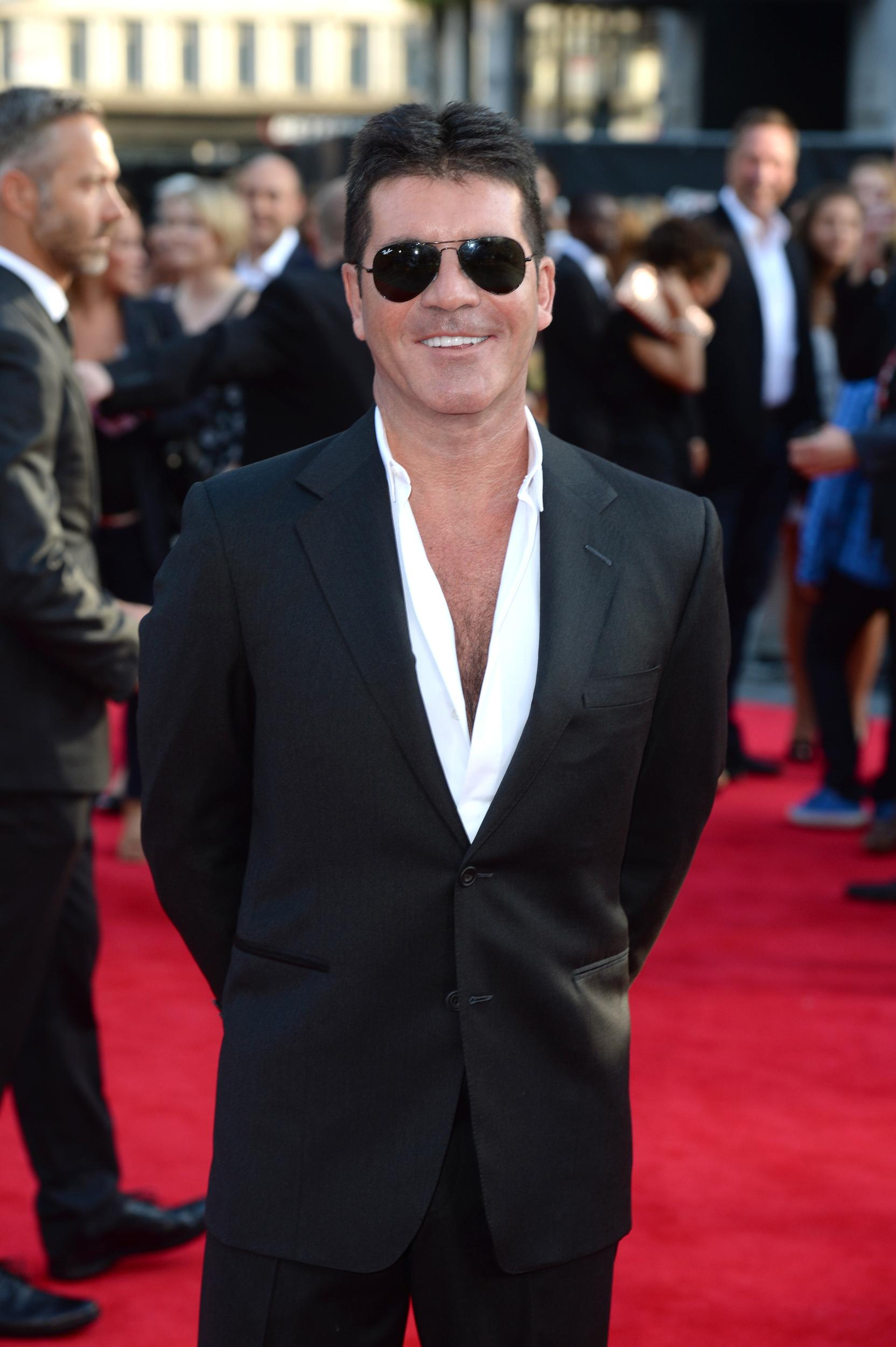 Simon Cowell, the second Brit on the list, is still holding fast to his earning power - despite some ratings problems in the US. The X Factor and Got Talent format are worldwide sensations - all earning a small fortune for the TV mogul and soon-to-be father who brought home $95 million in a year. It has pushed him up from tenth place in the list last year - leapfrogging the likes of James Patterson and Michael Bay.