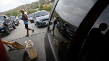 Soldiers oversee fuel rationing in some Venezuelan towns amid shortages