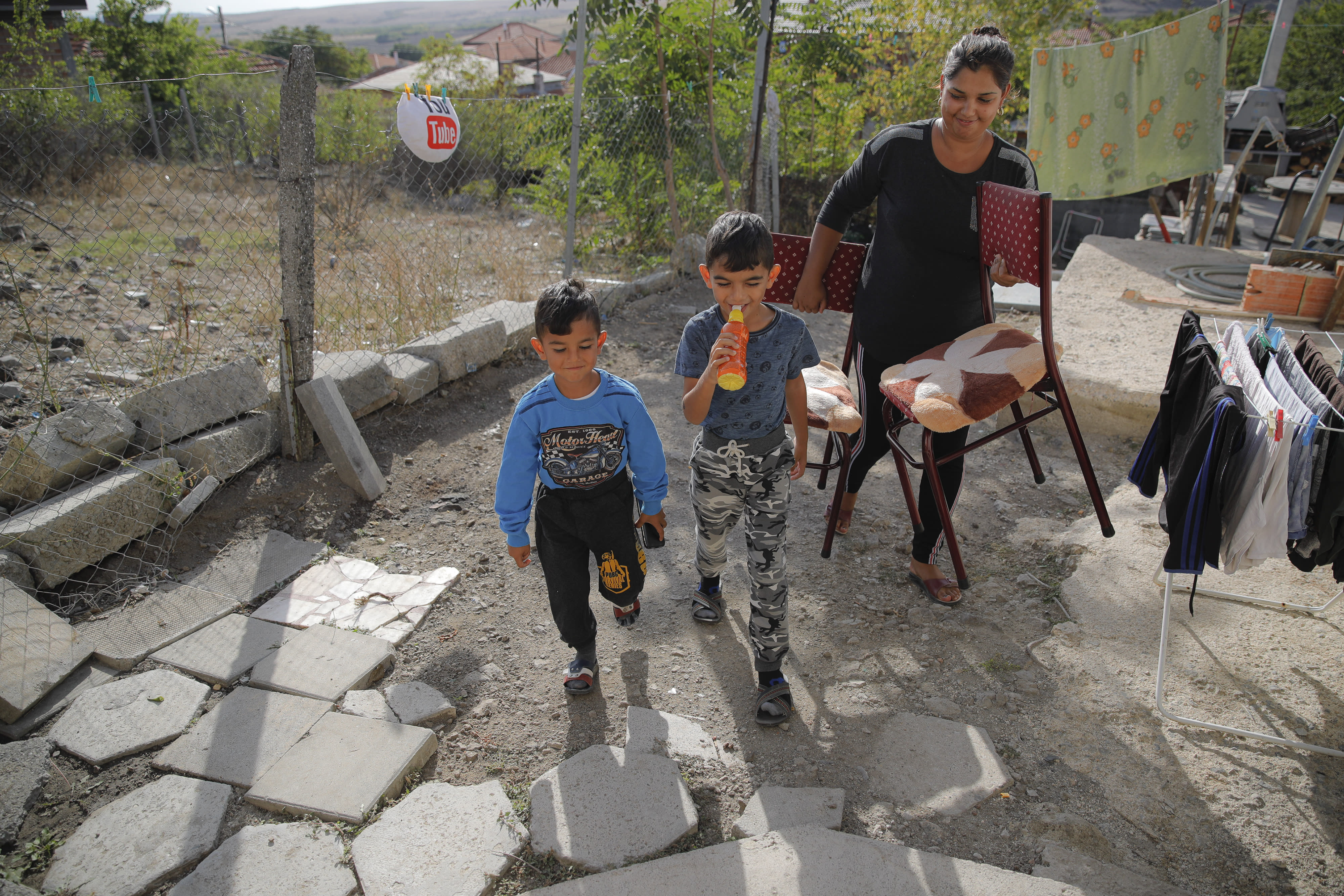 Bulgarian Roma children of the Topchu family walk in a village on the outskirts of Burgas, Bulgaria, Monday, Sept. 28, 2020. (AP Photo/Vadim Ghirda)