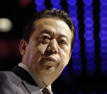 Wife: China's ex-Interpol boss jailed for reformist views